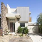 Facade of a contemporary double storey townhouse home